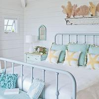 bedrooms - iron, bed, painted, blue, turquoise, blue, round, tables, nightstands, white, lamps, groove walls, blue, skirted, bench, blue, riffled, pillows, seafan, art, sea fan, seafan, sea fan decor, seafan decor, sea fan art, seafan art,