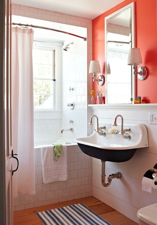 Traditional Home - bathrooms - Benjamin Moore - Tangerine Dream - Restoration Hardware Lugarno Single Sconce, Kohler Sink, tangerine, orange, walls, inset, medicine cabinet, white, blue, stripe, bath mat, rug, subway tiles, shower surround, brockway sink, tangerine paint colors, tangerine walls, tangerine bathroom walls,