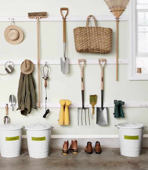 Country Living - garages - pale, green, walls, white, pails,  Ultra organized garage with pale green walls paint color and white pails.