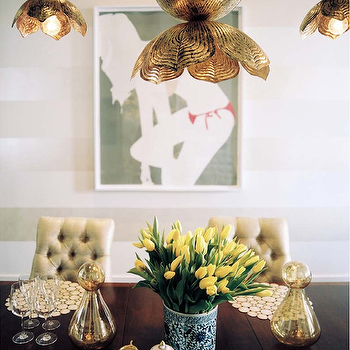 Sara Gilbane Interiors - dining rooms - white, gold, horizontal, stripe, walls, girl in bikini, art, metallic, gold, tufted, dining chairs, vintage, wood, dining table, jamie young flowering lotus pendant, flowering lotus pendant, lotus pendant, lotus chandelier, brass lotus pendant, brass flowering lotus pendant, Jamie Young Flowering Lotus Pendant, Natasha Law Art,