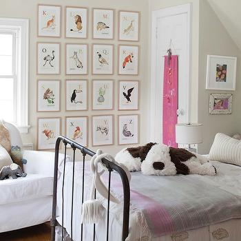 Adorable girl's bedroom with tan beige walls paint color, iron vintage bed, ...