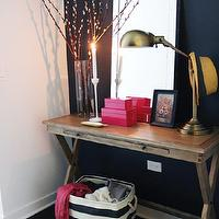 The Every Girl - entrances/foyers - navy blue, accent wall, hot pink, lacquer, boxes, West Elm Mirror-Framed Wall Mirror, World Market Campaign Console Table, The Container Store Rugby Stripe Bin, Ikea Blomster Candle Holders,