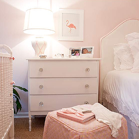 Elizabeth Newman Interior Design - nurseries - white, twin, headboard, pink, trim, white, ruffled, bedding, pink, trim, pink, bolster, pillow, pink, skirted, cube, ottoman, white, vintage, dresser, glass, flower, knobs, white, pink, lattice, lamp, pink, walls, pink, flamingo, art, Jenny Lind Crib,
