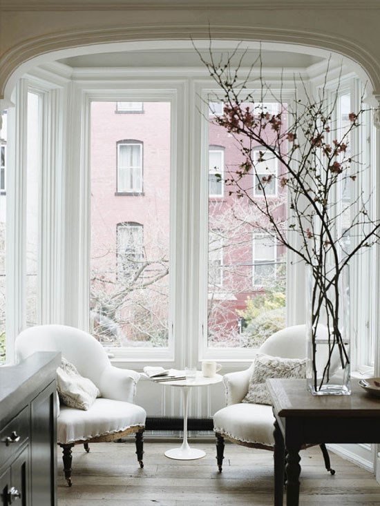 living rooms - white chairs curved arms black caster legs sakura cherry blossoms  Jenna Lyons  Gorgeous sitting room with white chairs with curved