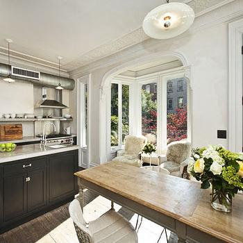 Jenna Lyons Sunny kitchen in Brooklyn townhouse with black kitchen