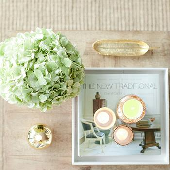 Breakfast at Toast - living rooms - hydrangeas, Gold Athena Tray, gold leaf tray, leaf tray, West Elm Jute Boucle Rug, Jayson Home Gold Athena Tray, Anthropologie Capri Blue Mercury Glass Candle, Ballard Designs Durham Bunching Table, West Elm Small Rectangle Lacquer Tray,