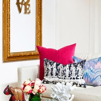 Design Manifest - living rooms - pink, blue, pillows, vintage, glass-top, round, coffee table, gold ornate, frame, Mitchell Gold + Bob Williams, Mitchell Gold + Bob Williams  sofa, Mitchell Gold + Bob Williams  slipcovered sofa, slipcovered sofa, empty gold frame, Mitchell Gold + Bob Williams Sofa, Jim Thompson Goddess Pillow,