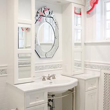 Kallista Metal Vanity Console flanked by white narrow mirrored cabinets with ...