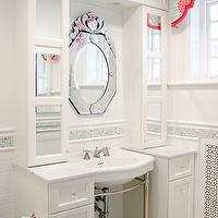 Kallista Metal Vanity Console flanked by white narrow mirrored cabinets with marble ...