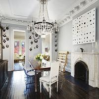 dining rooms - gray, walls, black, hutch, buffet, limestone, fireplace, rectangular, dining table, French, square, back, captain, dining chairs, ornate crown molding, crown molding, dining room crown molding, gray dining room walls,