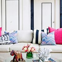 Design Manifest - living rooms - white, blue, stripe, sofa, vintage, round, glass-top, coffee table, pink, blue, pillows, mitchell gold, mitchell gold sofa, Mitchell Gold + Bob Williams Sofa, Jim Thompson Goddess Pillow,