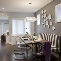 Leslie Goodwin Photography - dining rooms - purple, walls, charcoal, gray. walls, white, gray, stripe, slipcover, bench, banquette, mid-century modern, dining table, purple, throw, white, decorative, wall, plates, ghost chairs ikea, ikea ghost chairs, ghost chair ikea, ikea ghost chair, Z Gallerie Jupiter Chandelier, Ikea Tobias Chair,