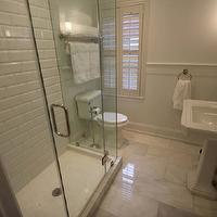 bathrooms - small shower, white bathroom, restoration hardware, subway tile, beveled subway tile, rain shower head, rain showerhead, kohler toilet, polished nickel, marble, Carrara marble, glass shower, frameless shower, shower, bathroom, small bathroom, sherwin williams, hexagon tile, beveled subway tile, beveled subway tile shower, white beveled subway tile, beveled subway tile shower, beveled subway tile bathroom,