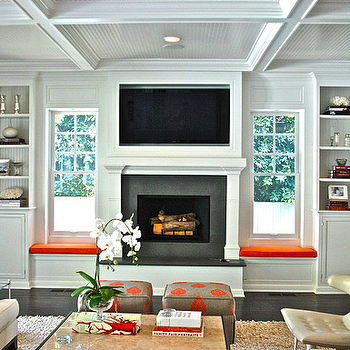 Jackson Page Interiors - living rooms - beadboard, coffered ceiling, gray, orange, skirted, ottomans, beadboard, lined, white, built-ins, window seas, orange, cushions, flanking, fireplace, champagne, leather, modern, tufted, chairs, ivory, sofa, built in window seats, window seats flanking fireplace, fireplace window seats, beadboard coffered ceiling, tv niche, fireplace tv, fireplace tv niche, fireplace flatscreen niche,