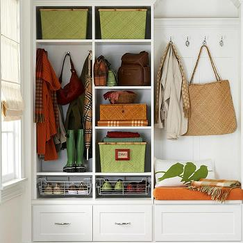 BHG - laundry/mud rooms - white, built-ins, green, woven, baskets, wire, shoe, baskets, orange, green, runner, green, cushion, built-in, bench, mudroom, mudroom design, mudroom cabinets, mudroom storage, mudroom bench, mudroom cubbies, mudroom pin boards, mudroom cork boards, mudroom hooks, mudroom baskets, mudroom bins,