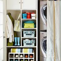 BHG - laundry/mud rooms - stacked, champagne, metallic, washer, dryer, built-ins, plastic, pails, storage, baskets, white, rolling, shoe rack,