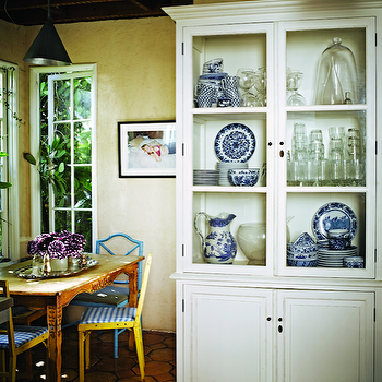 C Magazine - dining rooms - white, hutch, sheet, metal, cone, pendants, Jacqui, Getty, rustic, dining table, blue, faux bamboo, chairs, yellow, dining chairs, blue, gingham, fabric, seat, cushions, glass front china cabinet, white china cabinet, turquoise dining chairs, turquoise blue chairs, turquoise chairs, turquoise bamboo chairs, turquoise bamboo dining chairs, turquoise faux bamboo chairs,