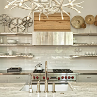 Buckingham Interiors - kitchens - gray, modern, kitchen cabinets, stainless steel, countertops, sink in kitchen island, marble, countertops, subway tiles backsplash, stainless steel, floating shelves, white, faux, antlers, chandelier, stainless steel shelves, stainless steel floating shelves, floating shelves, floating kitchen shelves, floating stainless steel shelves, floating stainless steel kitchen shelves, floating stainless steel shelves kitchen,
