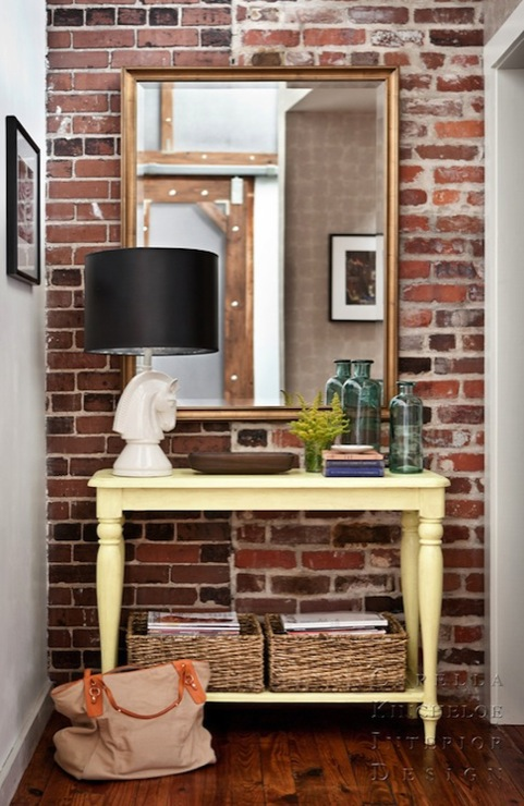 Capella Kincheloe Interior Design - entrances/foyers - recycled, glass, vases, exposed brick wall, mirror, butter, yellow, painted, console, table, turned legs, white, horse, head, lamp, black, lamp, shade, woven, storage, baskets, yellow console table, yellow foyer table,