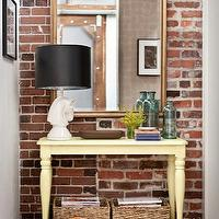 Capella Kincheloe Interior Design - entrances/foyers - recycled, glass, vases, exposed brick wall, mirror, butter, yellow, painted, console, table, turned legs, white, horse, head, lamp, black, lamp, shade, woven, storage, baskets,