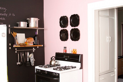 Design Sponge - kitchens - Ralph Lauren - Mademoiselle - pink, accent, wall, black, chalkboard, wall, stainless steel, shelves, pink walls, pink paint colors, pink paint, pink kitchen walls, pink and black kitchen,