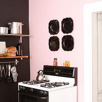 Design Sponge - kitchens: pink, accent, wall, black, chalkboard, wall, stainless steel, shelves, pink walls, pink paint colors, pink paint, pink kitchen walls, pink and black kitchen,