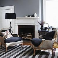 House & Home - living rooms - gray, walls, gray, linen, Bergere, chairs, navy blue, velvet, cushions, gray, striped, rug, fireplace, ebony, demilune, table, grey paint, grey paint colors, grey walls, grey living room walls,