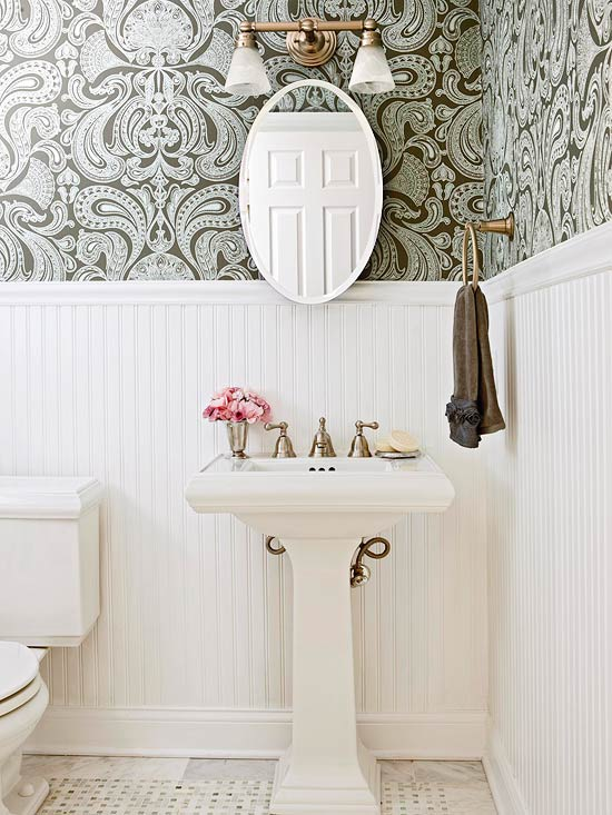 BHG - bathrooms - light, gray, chocolate, brown, dam ask, wallpaper, chair rail, beadboard, oval, pivot, mirror, pedestal, sink, marble, tiles, floor, marble, basket weave, inset, tiles, brass, ring, towel holder, frosted, clear, glass, brass, double sconce, pink, accent,