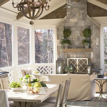 Linda McDougald Design - decks/patios: slate, tiles, floor, trestle, dining table, linen, slipcover, captain, dining chairs, stone, fireplace, sunroom, wood beams, wine barrel chandelier,