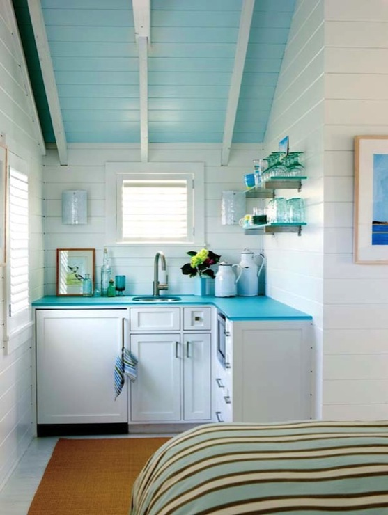 Kathleen Hay Design - kitchens - sloped ceiling, painted, turquoise, blue, vintage, glass shelves, kitchenette, white, cabinets, sea blue, countertops, jute, rug, turquoise countertops, turquoise blue countertops, guest house, turquoise ceiling, turquoise blue ceiling, kitchenette, turquoise kitchenette,