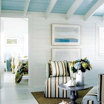 Kathleen Hay Design - living rooms - beachy, blue, sloped ceiling, white, wood beams, white, brown, blue, striped, matching, chairs, gray, pedestal, table, seagrass, rug, guest house, turquoise ceiling, turquoise plank ceiling,