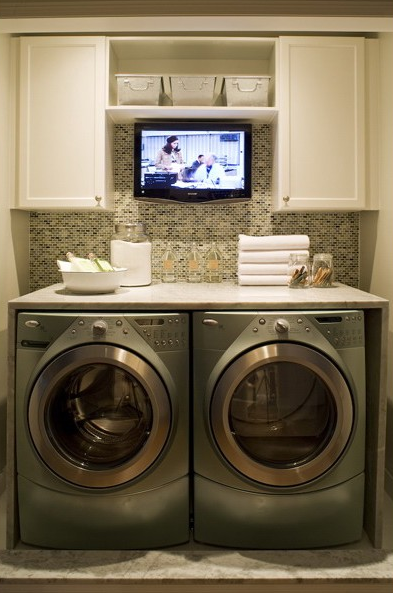 Toronto Interior Design Group - laundry/mud rooms - mosaic, tiles, backsplash, metallic, front-load, washer, dryer, marble, slab, countertop, marble, tiles, floor, TV, built-in, shelf, canvas, baskets, cabinets, laundry room, laundry room tv, tv in laundry room,