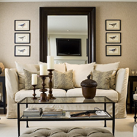 Toronto Interior Design Group - living rooms - mushroom, grasscloth, wallpaper, accent wall, gray, walls, espresso, stained, beveled, mirror, off-white, slipcover, sofa, ebony, end tables, black, cane, chairs, striped, cushions, art, gray, tufted, ottoman, bench, mirror behind sofa, mirror behind couch,