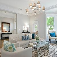 Cardea Building Co. - living rooms - ivory, tufted, chairs, teal, blue, pillows, gray, walls, oatmeal, linen, tufted, modern, sofa, mirrored, cocktail table, oatmeal, linen, barrel, chair, mirrored coffee tables, mirrored cocktail tables, mirror coffee table, Jonathan Adler Ventana 2 Tier Chandelier, Khanjali Ikat Pillow,