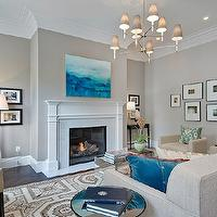 Cardea Building Co. - living rooms - gray, walls, marble, fireplace, surround, art gallery, oatmeal, linen, tufted, sofa, oatmeal, linen, barrel, chair, ivory, tufted, chairs, blue, pillows, mirrored, cocktail table, gray walls, gray paint, gray paint colors, greige paint, greige walls, greige paint colors, greige paint color, gray beige paint, gray beige walls, Jonathan Adler Ventana 2 Tier Chandelier, Khanjali Ikat Pillow,