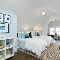 Boys' attic bedroom with blue walls paint color, skylights, ivory & brown striped ...