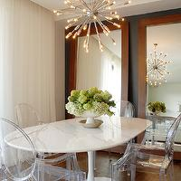 Annette English - dining rooms - twin, wood, floor, mirrors, black, walls, sputnik, chandelier, saarinen table, saarinen dining table, saarinen dining room table, oval saarinen table, saarinen table oval, Oval Saarinen Table, Kartell Ghost Chair,
