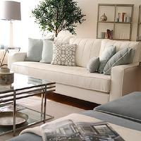 Elegant living room design with white sofa slate blue pillows with
