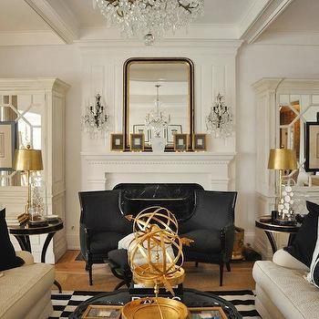 Megan Winters - living rooms - ivory, mirrored, cabinets, armoires, flanking, fireplace, ivory, linen, sofas, black, gold, pillows, glossy, black, bergere chairs, gold, lamps, mirrored armoire,