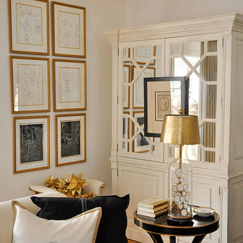Megan Winters - living rooms - ivory, mirrored, cabinet, gold leaf, frames, art gallery, ivory, linen, sofa, gold, black, pillows, black, gold, accent table, mirrored armoire, white mirrored armoire,