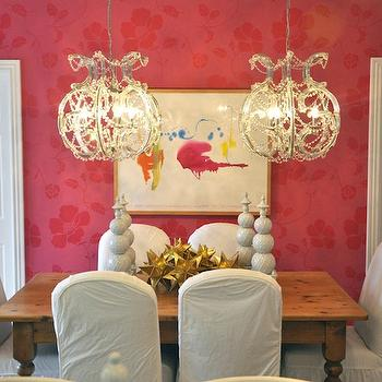 Megan Winters - dining rooms - pink, floral, wallpaper, twin, crystal chandeliers, salvaged wood, dining table, turned legs, white, slipcover, dining chairs, pink dining room, pink wallpaper, pink floral wallpaper,