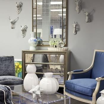 Martha O'Hara Interiors - living rooms - gray, walls, mirrored, chest, mirror, blue, silk, bergere, chair, acrylic, lucite, cube, trunks, coffee table, blue, velvet, modern, slipper, chairs, white, piping, blue, gray, rug, gray walls, gray paint, gray paint colors, blue chair, blue velvet chair,