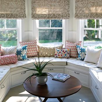 Bella Mancini Design - decks/patios - sunroom, beige, floral, roman shades, white, built-in, window seats, storage, blue, red, pillows, round, mid-century, coffee table, curved window seat, built in window seat, built in curved window seat,