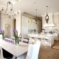 Dodson and Daughter Interior Design - dining rooms - tan, walls, crystal chandelier, salvaged wood, dining table, purple, leather, carved wood, dining chairs, white, ruffled, slipcover, captain, dining chairs, lilac, silk, drapes,