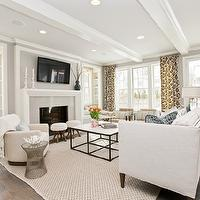 Refined LLC - living rooms - glossy, white, wood beams, gray walls, built-in, window seats, flanking, TV over fireplace, ivory, swivel chair, ivory chevron herringbone rug, off-white, linen, modern, sofa, marble, top, iron, coffee table, wall, French doors, Knoll Platner Side Table, Oly Studio The Petite Kedan Footstool,
