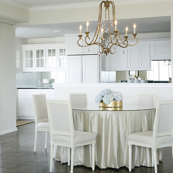 Ashley Goforth Design - dining rooms - brass, scroll, chandelier, white, French, square back, dining chairs, upholstered, light gray, fabric, ivory, silk, skirted round dining table, glass-top, skirted dining table, round skirted dining table,
