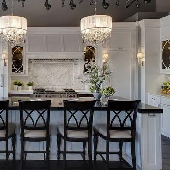 Airoom - kitchens - creamy, white, kitchen cabinets, calcutta, gold, countertops, calcutta, gold, marble, slab, backsplash, chair rail frame, inset, tiles, white, kitchen island, glossy, black, beveled, countertop, crystal chandelier, , Ann Sacks Beau Monde Grace Tiles,