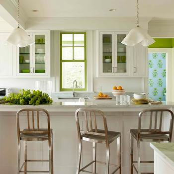Katie Ridder - kitchens - white, glass, front, kitchen cabinets, frosted, glass, shelves, white, kitchen island, breakfast bar, marble, countertops, crumpled, bowl, pendant, lights, green, accents, 1006 Navy, counter stools,