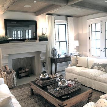 Figless Manor - Chic, cozy living room with framed TV over stone fireplace, ...