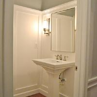 Sixteen Fourteen - bathrooms - gray, walls, wall moldings, glossy, white, pedestal, sink, rectangular, pivot, mirror, gray walls, grey walls, gray paint, grey paint, gray paint color, grey paint color, gray wall paint, grey wall paint, gray bathroom walls, grey bathroom walls, gray bathroom paint, grey bathroom paint, gray bathroom paint color, grey bathroom paint color, Restoration Hardware Keller Sconce,
